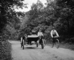 Milton (Massachusetts), Edward Blake Clapp in automobile next to cyclists