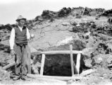 Platte County (Wyoming), man at entrance to copper prospecting hole