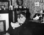 Pittsburgh (Pennsylvania), woman doing needlework in sitting room