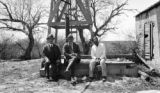 Texas, Frederick Gardner Clapp and two men seated outdoors