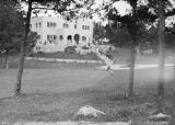 United States, Ethel Herzfeld on lawn near building