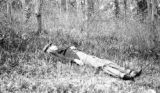 Paget Parish (Bermuda), man laying on grass in woods north of Hungry Bay