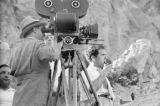 United States, Frank Capra standing next to camera on set of 'Lost Horizon'