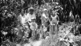 Mexico, Harriet Platt with Pais family in their garden in La Magdalena Atlipac