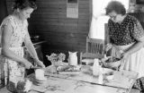 Canada, women preparing meal in home