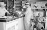 Canada, men at counter of general store in Saskatchewan
