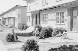 Canada, children playing on lawn of home in Vancouver