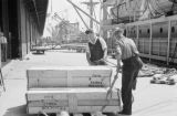 Canada, men working at Montréal port on Saint Lawrence River