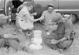 Canada, farmers resting in field for meal in Saskatchewan