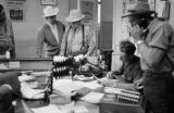 Canada, group of men working in stockyard office