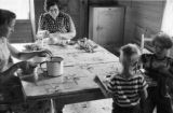 Canada, family preparing meal at table in home