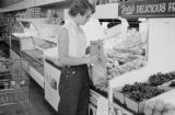 Canada, woman grocery shopping with boy in Saskatchewan