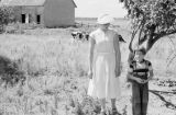 Canada, woman with boy in field on farm