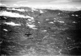 Mexico, aerial view of mountain range and river winding through foreground