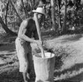 Haiti, man working with mortar and pestle