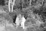 Guatemala, Harriet Platt and man standing near ancient stone carving at Quiriguá