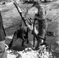 United States, men clearing stream in Sunbury