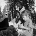 United States, woman and daughter preparing meal at Yellowstone National Park