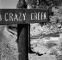 United States, sign for Crazy Creek at Yellowstone National Park in Park county