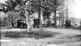 United States, cars parked around camp site in Marquette