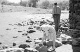 United States, man and woman at stream in California