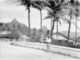 Avarua (Cook Islands), people on street in town with mountains in distance