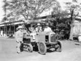 Broome (Australia), men ride on tractor at Continental Hotel