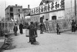 Chongqing (China), people walking through a gate of chevaux-de-frise