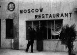 Chongqing (China), men repairing a window at the Moscow Restaurant