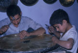 Esfahan province (Iran), man and boy carving metal platter