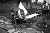 Chongqing (China), children carrying stretcher, possibly for sick or wounded