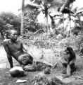 Narathiwat province (Thailand), man and a monkey