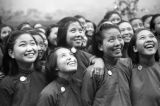 Chongqing (China), women smiling and looking up