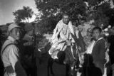 Yanan (China), Eighth Route Army soldiers with captured Japanese soldier riding on donkey