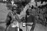 Yanan (China), Eighth Route Army soldier and man posing with bottle
