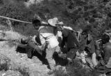 Yanan (China), men carry wounded soldier on stretcher