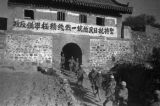 Yanan (China), Eighth Route Army soldiers walking through city gate