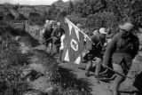 Yanan (China), Eighth Route Army soldiers walking path with flag