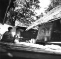 Phetchabun province (Thailand), woman ginning cotton in her home