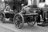 Shanghai (China), soldiers riding on wheeled cannon