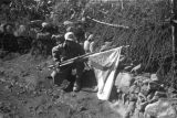 Yanan (China), Eighth Route Army soldier holding Japanese flag