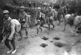 Yan'an (China), Eighth Route Army soldiers walk around holes dug for mines