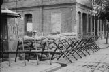 Shanghai (China), Japanese soldiers stand behind barricade on commercial street