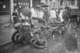 Shanghai (China), people looking at remains of damaged car on street