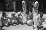 Shanghai (China), one of several images of wounded sailor and others on ship deck