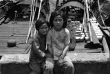 Shanghai (China), two girls with sampans