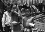 Shanghai (China), children standing in front of drying fish