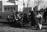 Shanghai (China), people sitting on cart in front of former Shanghai Civic Center