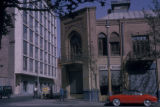 Tehran (Iran), quiet street corner with car and people