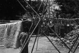 China, bamboo structure holding fish and blanket to dry